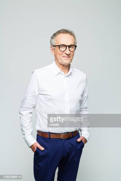 portrait of friendly senior businessman - white shirt stock pictures, royalty-free photos & images