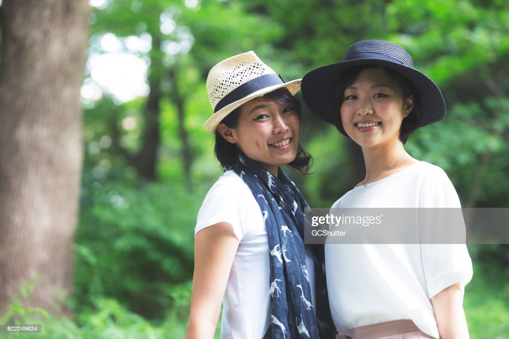 Portrait of friends in a public park : Stock Photo