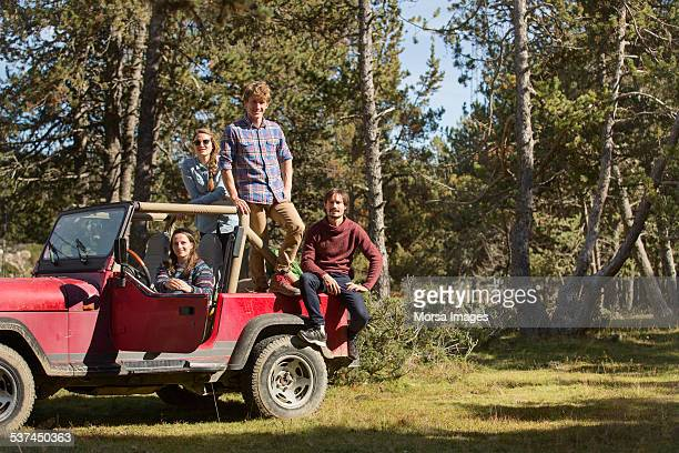 portrait of friends on suv - four people in car stock pictures, royalty-free photos & images