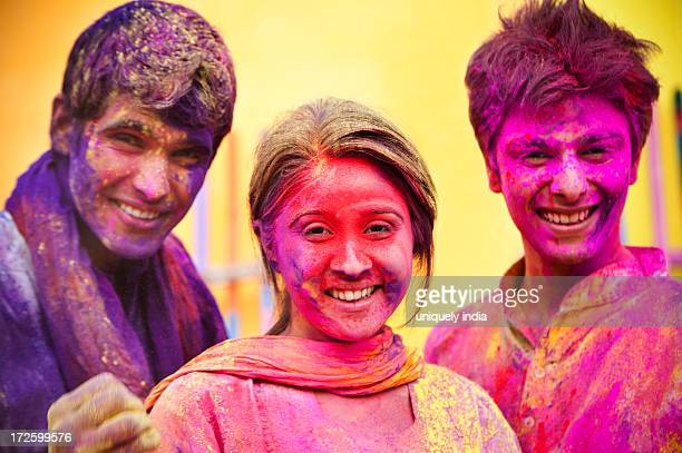 Portrait of friends posing during Holi