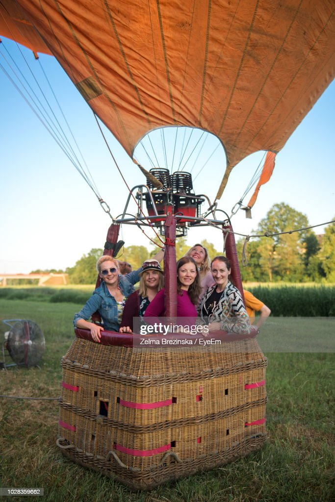Portrait Of Friends Standing In Hot Air Balloon : Stock Photo