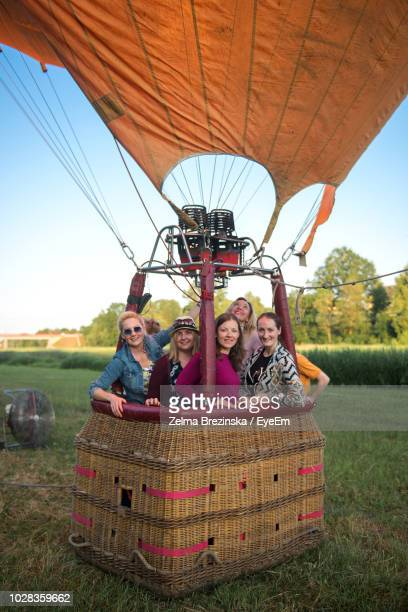 portrait of friends standing in hot air balloon - latvia stock pictures, royalty-free photos & images