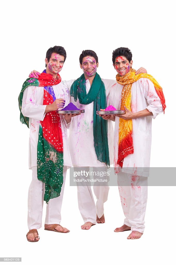 Portrait of friends with holi colours : Stock Photo