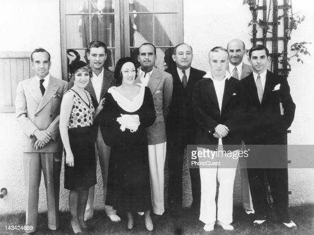 Portrait of from left Al Jolson Mary Pickford Ronald Colman Gloria Swanson Douglas Fairbanks Sr unknown Charlie Chaplin unknown and Eddie Cantor 1920s