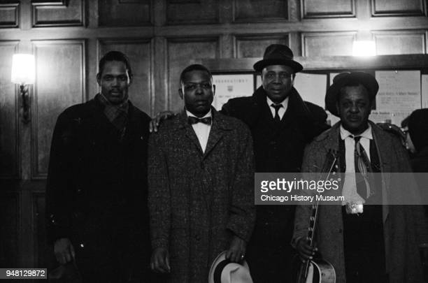 Portrait of from left American Blues musicians Big Walter Horton Floyd Jones 1917 1989 Sunnyland Slim and Big Joe Williams as they pose backstage at...