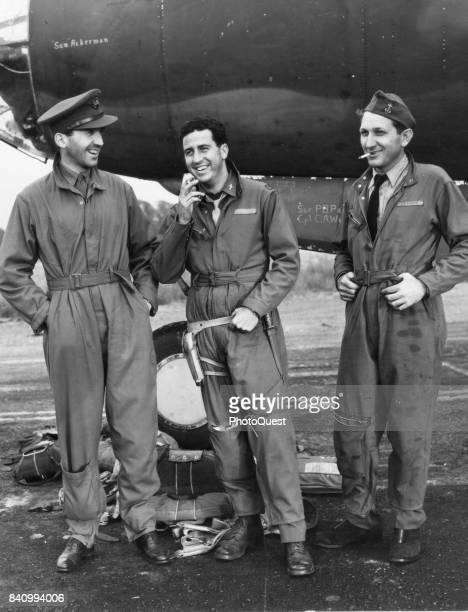 Portrait of from left American broadcast journalist Edward R Murrow group deputy commander Lt Col Harry G Hankey and CBS technician Gene Rider as...