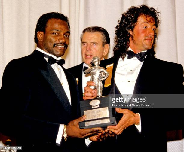 Portrait of, from left, American former football player Walter Payton , football coach George Allen , and film actor, writer, and director Sylvester...