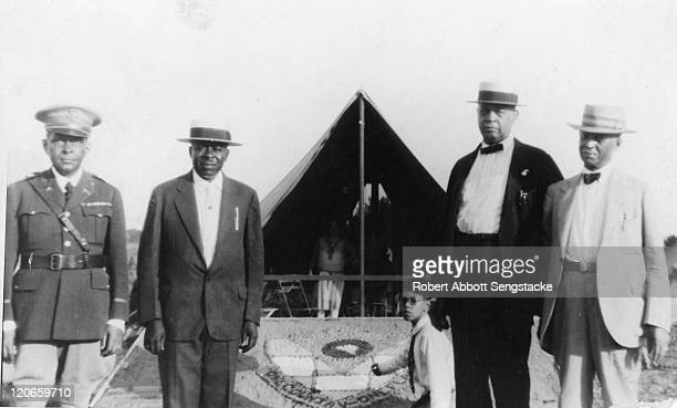 Portrait of, from left, American Lieutenant Colonel Otis B. Duncan , newspaper publisher Robert Sengstacke Abbott , politician Oscar de Priest , and...