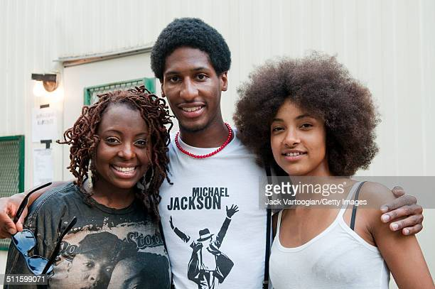 Portrait of from left American musicians Ledisi Jonathan Batiste and Esperanza Spalding as they pose backstage at Central Park SummerStage New York...