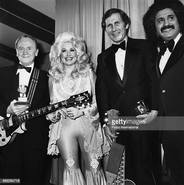 Portrait of, from left, American musicians Les Paul , Dolly Parton, Chet Atkins , and Freddie Fender , as they pose together during the 19th annual...