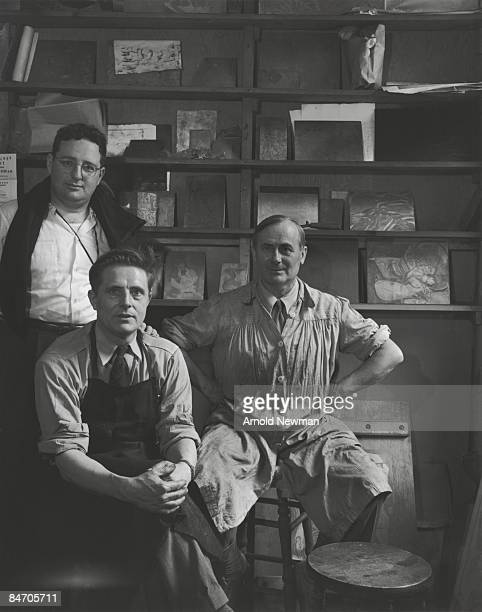 Portrait of from left American photographer Arnold Newman British Abstract Expressionist artist Stanley William Hayter Spanish Surrealist artist Joan...