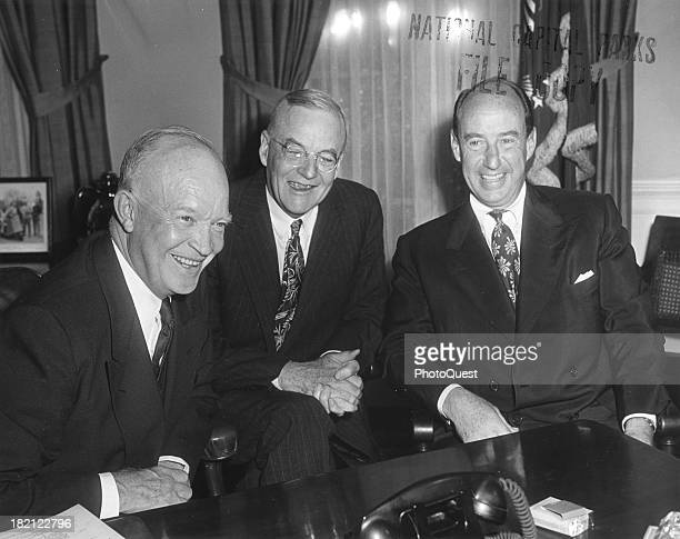 Portrait of from left American politicians US President Dwight Eisenhower US Secretary of State John Foster Dulles and Adlai Ewing Stevenson II as...
