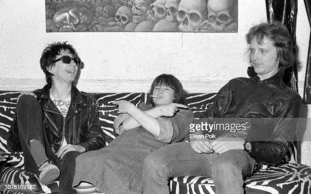 Portrait of from left American Punk musician Stiv Bators of the group Dead Boys visibly pregnant Damita Richter and Bators' bandmate Jimmy Zero as...