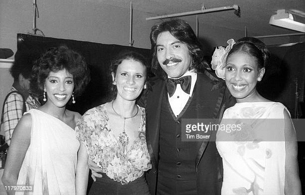 Portrait of from left American singers Joyce Vincent unidentified Tony Orlando and Thelma Hopkins backstage at the 17th Grammy Awards held at the...
