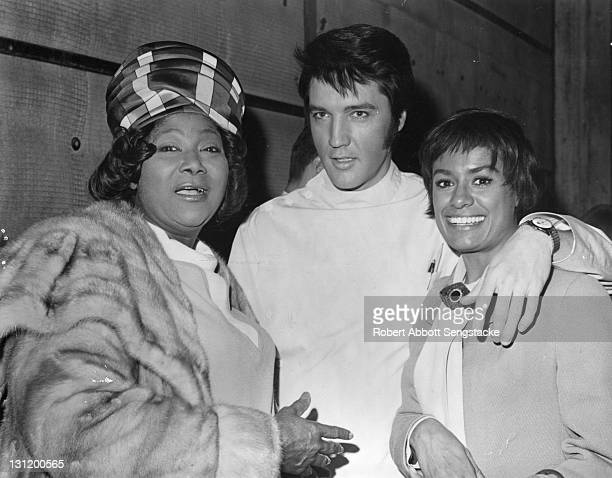 Portrait of from left American singers Mahalia Jackson Elvis Presley and Barbara McNair as they pose together 1969