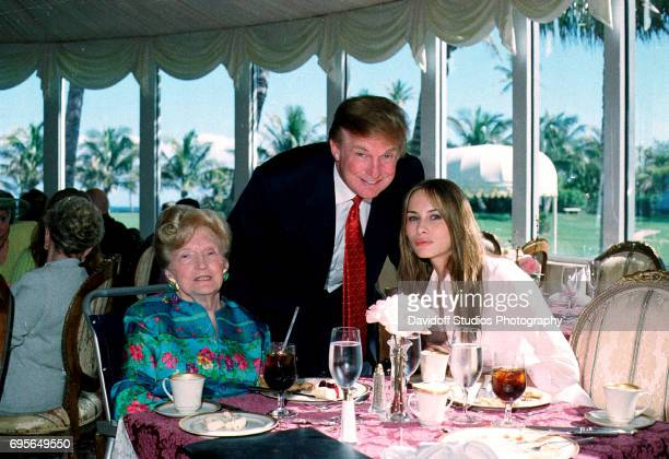 Portrait of from left American socialite Mary Trump her son real estate developer Donald Trump and his girlfriend former model Melania Knauss as they...