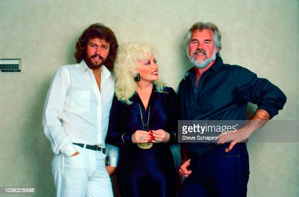 Portrait of, from left, British musician Barry Gibb, American musician and actress Dolly Parton, and musician and actor Kenny Rogers as they pose...