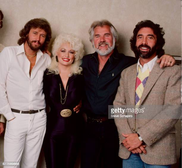 Portrait of from left British musician Barry Gibb American musician and actress Dolly Parton musician and actor Kenny Rogers and talent agent Sandy...