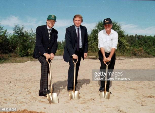 Portrait of from left businessman Alfons Schmitt real estate developer Donald Trump and golf course architect Jim Fazio each with a 'golden' shovel...