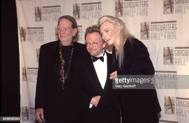 Portrait of from left Country musician Willie Nelson Pop musician and composer Paul Williams and Folk musician Judy Collins as they attend the...