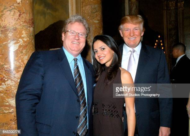 Portrait of from left couple American philanthropist Patrick Park and Nathalie Fernandez and real estate developer Donald Trump as they attend a...
