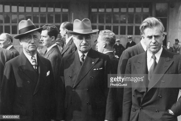Portrait of from left Director of the Office of War Mobilization James F Byrnes President Harry S Truman and Secretary of Commerce Henry A Wallace...