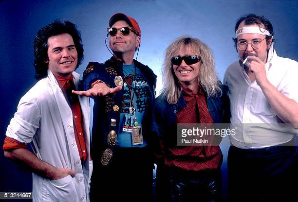 Portrait of from left Jon Brandt Rick Nielsen Robin Zander and Bun E Carlos of the band Cheap Trick as they pose at the Poplar Creek Music Theater...