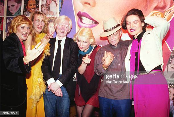 Portrait of from left Lorna Luft Jerry Hall Andy Warhol Debbie Harry Truman Capote and Paloma Picasso at the Interview party at Studio 54 New York...