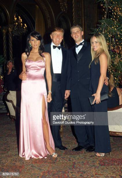 Portrait of from left model Melania Knauss and real estate developer Donald Trump Trump's son Eric and the latter's girlfriend Lara Yunaska as they...