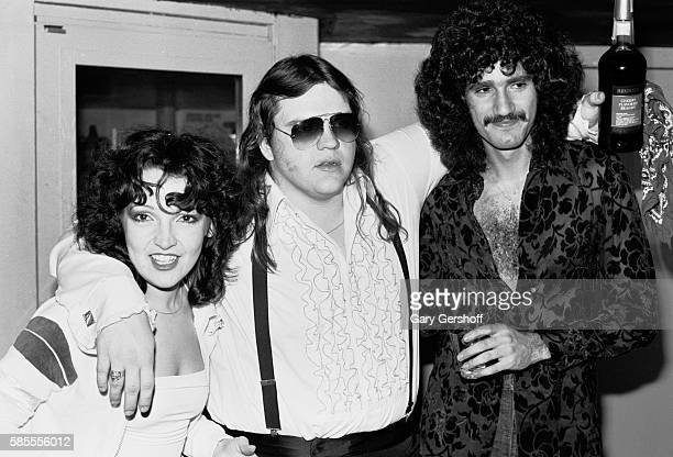 Portrait of from left musicians Karla DeVito Meat Loaf and Bruce Kulick as they pose backstage at My Father's Place nightclub Roslyn New York...