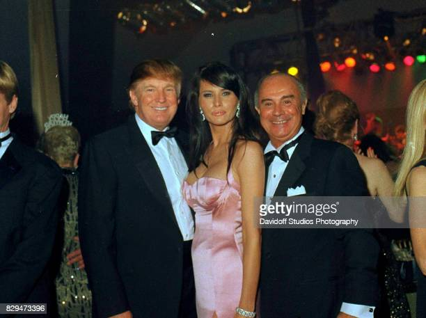 Portrait of from left real estate developer Donald Trump and model Melania Knauss and convicted felon and businessman Joe Cinque as they pose...
