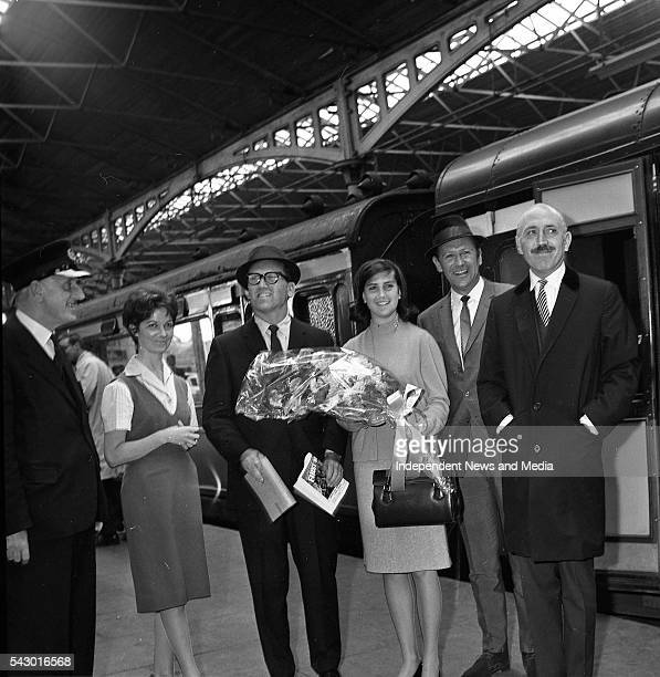 Portrait of from left Station Master PF Kelly hostess Deidre McVeigh film producer Charles H Schneer and his daughter Lesley and film stars Edward...