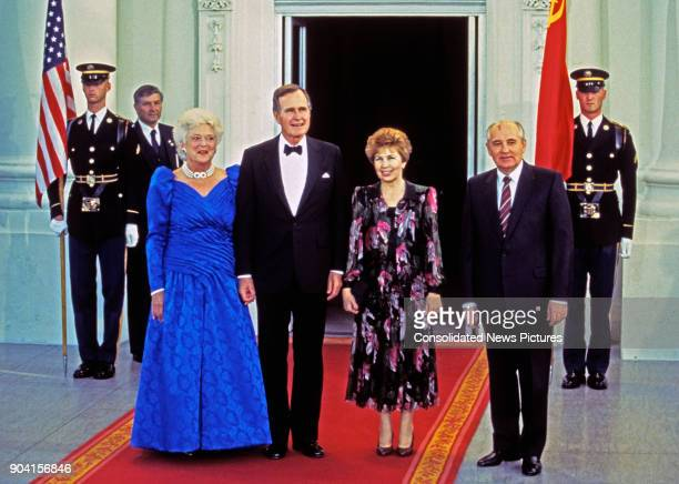 Portrait of from left US First Lady Barbara Bush and her husband US President George HW Bush Raisa Gorbacheva and her husband Soviet President...
