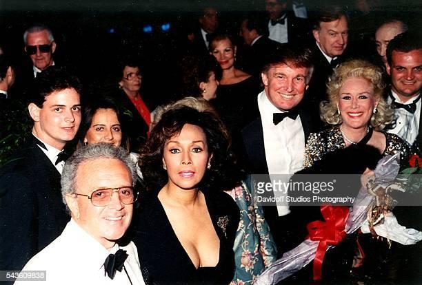 Portrait of front row from left American singer Vic Damone actress Diahann Carroll businessman Donald Trump and British philantropist Celia Lipton...