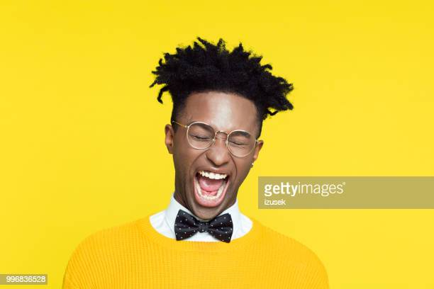 portrait of frustrated nerdy young man in retro style - izusek stock pictures, royalty-free photos & images