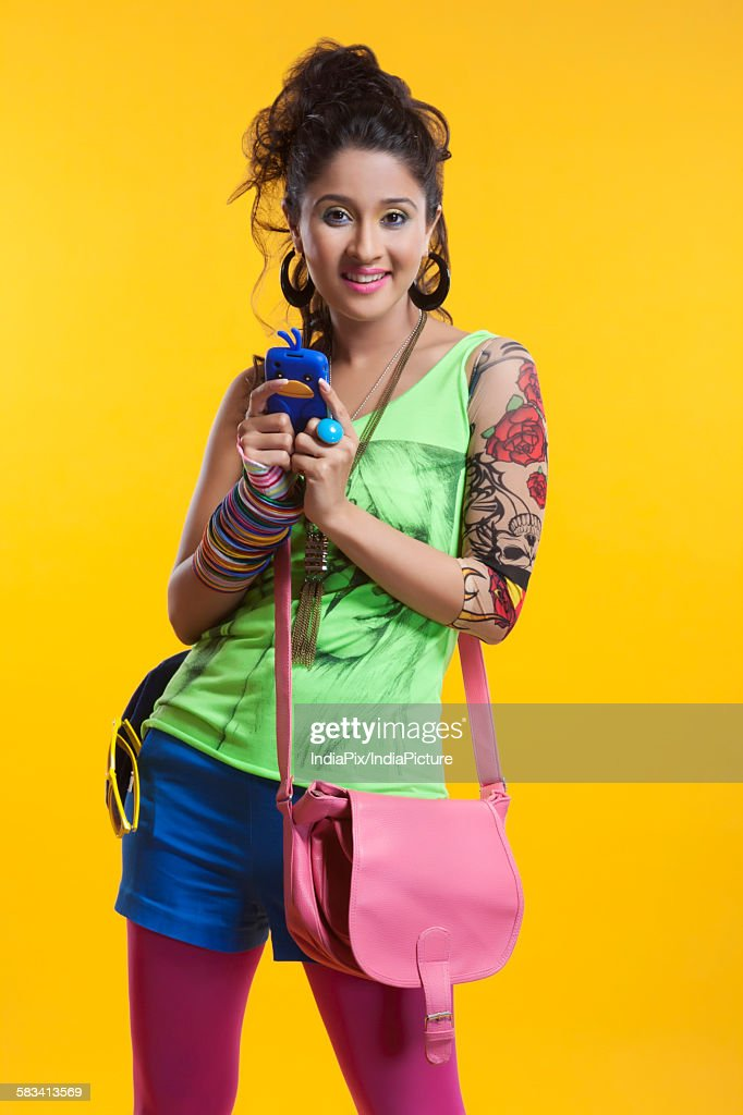 Portrait of funky woman with mobile phone : Stock Photo