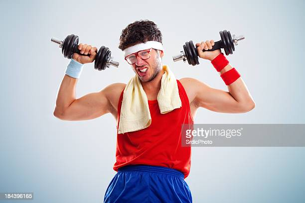Portrait of funny looking body builder lifting weights