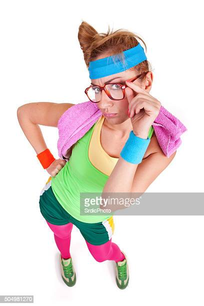 Portrait of funny nerdy fitness girl with glasses looking up