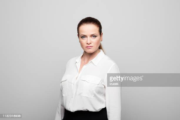 portrait of furious mature businesswoman - bossy stock pictures, royalty-free photos & images