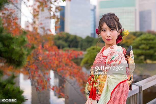Portrait of Furisode girl in autumn garden