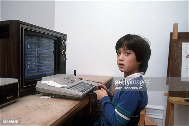 Portrait of future musician Sean Lennon as he plays a video game in his home at the Dakota Apartments New York New York November 13 1982 He is...