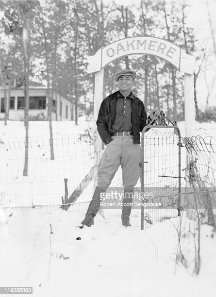 Portrait of future newspaper publisher John H Sengstacke as he poses in the snow at the entrance gate to the Oakmere Hotel Idlewild Michigan 1938 The...