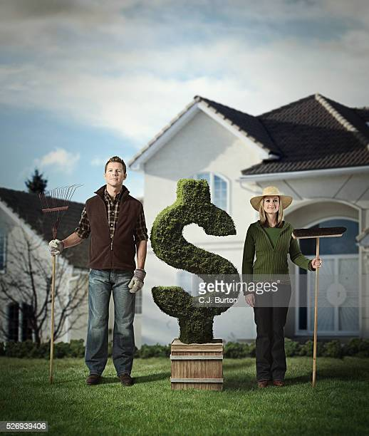 Portrait of gardeners standing next to dollar shaped plant