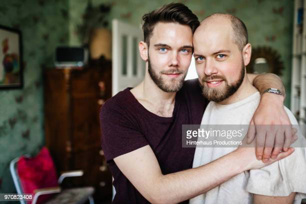 Portrait Of Gay Couple At Home