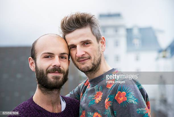 Portrait of gay couple smiling