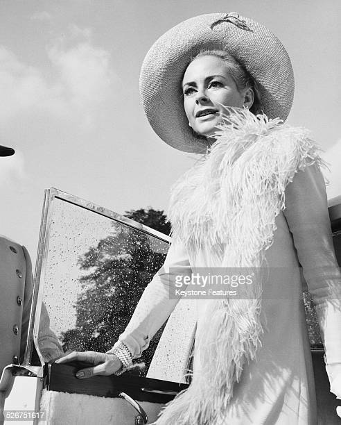 Portrait of Genevieve Page stepping out of a Rolls Royce, in a scene from the film 'Decline and Fall...of a Birdwatcher', 1968.