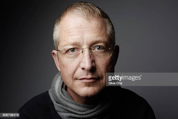 portrait of gentle looking 46 year old male - neckline stock pictures, royalty-free photos & images