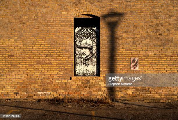 Portrait of George Floyd covers a window outside the Hook and Ladder theater on April 1, 2021 in Minneapolis, Minnesota. The Derek Chauvin murder...