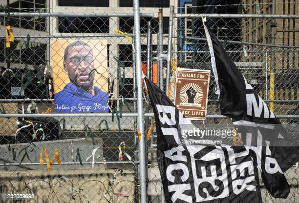 Portrait of George Floyd hangs on the fencing outside the Hennepin County Government Center on April 1, 2021 in Minneapolis, Minnesota. The Derek...