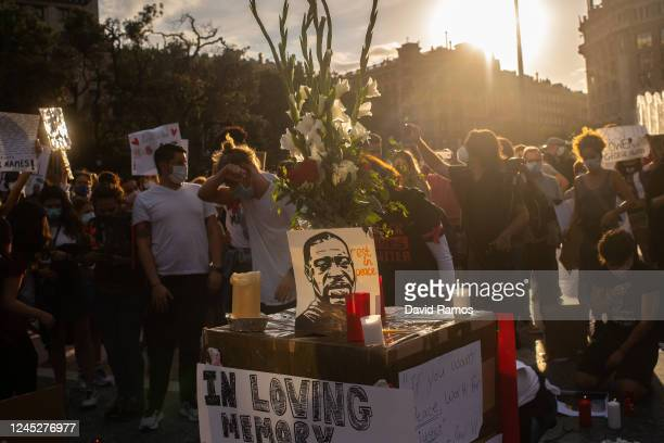 A portrait of George Floyd is displayed on a box as demonstrators gather to mourn the death of George Floyd during a vigil at Catalunya Square on...